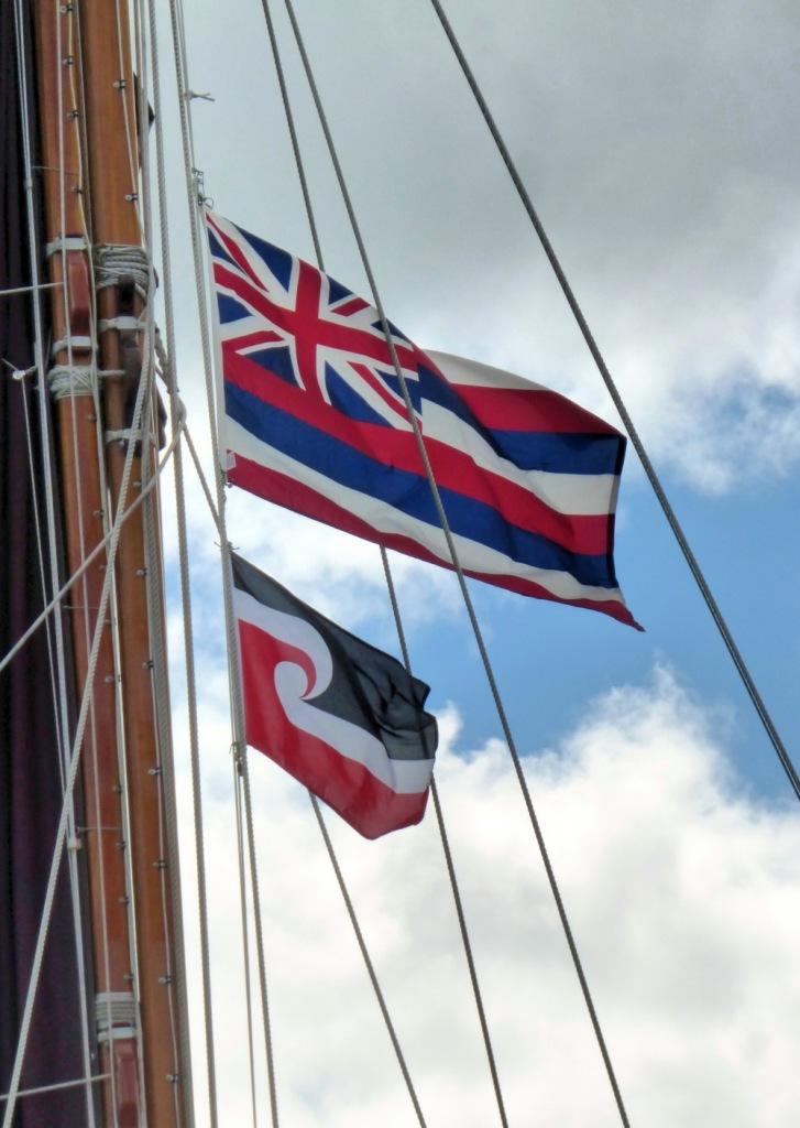 Hōkūle'a Displaying Hawaiian and Maori Flags