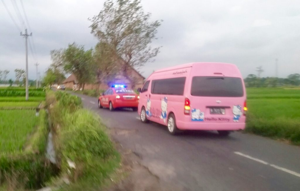 Police Escort With Hello Kitty Van in Two Image Courtesy Melian Tomsett